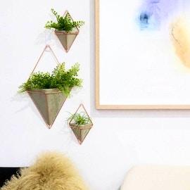 Vasi geometrici in ceramica e rame